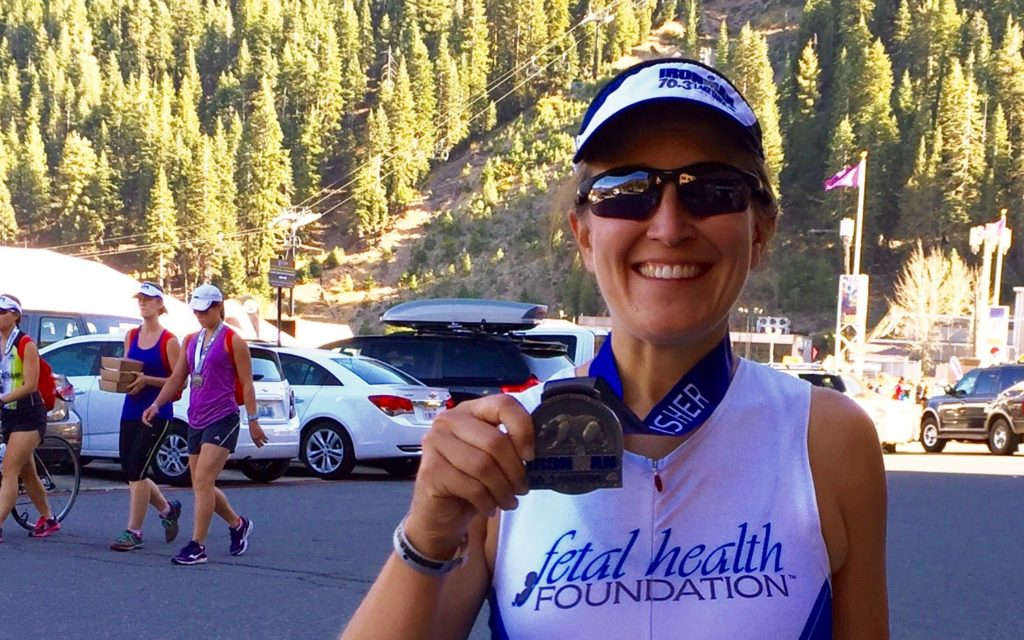 Kate Young shows off her half-ironman medal